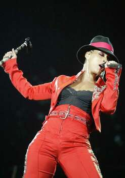 American artist Alicia Keys performs Sunday, June 6 2004, during the last night of the Rock in Rio-Lisboa music festival in Lisbon, Portugal. The festival that drew hundreds of thousands of spectators also featured Paul McCartney, Sting, Britney Spears and Peter Gabriel, among others. Photo: PAULO AMORIM, AP / AP