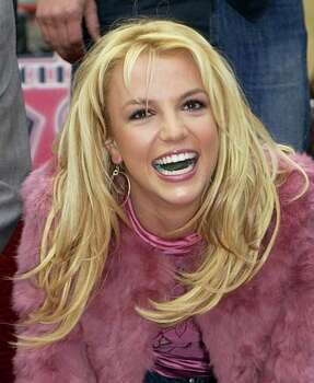 Pop star Britney Spears smiles at photographers as she is honored with the 2,242nd star on the Hollywood Walk of Fame, Monday, Nov. 17, 2003, in Los Angeles. Photo: NICK UT, AP / AP