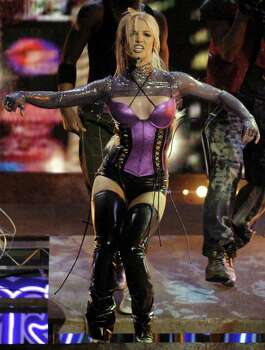 "Britney Spears performs ""Me Against the Music"" during the 31st annual American Music Awards, Sunday, Nov. 16, 2003, in Los Angeles. Photo: MARK J. TERRILL, AP / AP"