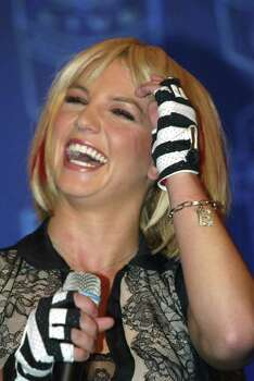 "Britney Spears laughs during Washington news conference Wednesday, Sept. 3, 2003 to promote Thursday's ""NFL Kickoff Live 2003."" on the Mall. So, how did Britney Spears' parents react when the 21-year-old pop star locked lips with Madonna on the MTV Video Music Awards?  ""Well, my mom liked it actually. I was really kind of nervous! I was like, `Oh my God, my mom ... she's going to see this!''' Spears told Billy Bush in an interview on ""Access Hollywood.'' Excerpts from Thursday, Sept. 4, 2003 show were released in advance. Photo: MATTHEW CAVANAUGH, AP / AP"