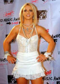 Singer Britney Spears poses in the press room during the MTV Video Music Awards outside New York's Radio City Music Hall Thursday, Aug. 28, 2003. Photo: MARY ALTAFFER, AP / AP
