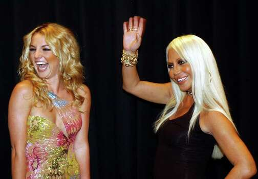 Italian fashion designer Donatella Versace greets the audience while U.S. pop singer Britney Spears laughs at the end of the Versace Spring-Summer 2003 fashion collection, designed by Donatella Versace and presented in Milan, Italy, Tuesday, Oct. 1, 2002. (AP Photo/Luca Bruno) Photo: LUCA BRUNO,  AP / AP