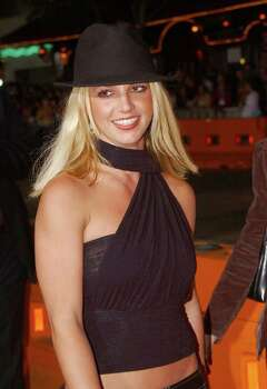 "Pop star Britney Spears poses for photographers at the world premiere of ""The Four Feathers,"" Tuesday, Sept. 17, 2002, in the Westwood section of Los Angeles. Photo: RENE MACURA, AP / AP"
