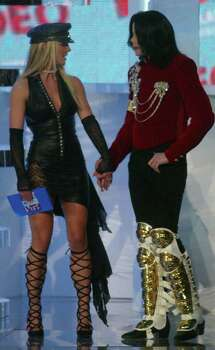 "Michael Jackson, right, accepts a special ""Artist of the Millennium"" award from Britney Spears during the MTV Video Music Awards at New York's Radio City Music Hall, Thursday, Aug. 29, 2002. Photo: BETH KEISER, AP / AP"
