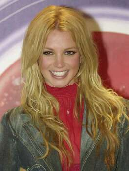 ** FILE ** Pop star Britney Spears poses for a photograph in this July 26, 2002 file photo, in Mexico City. Spears is far from upset over her parents' recent divorce.  ``It's the best thing that's ever happened to my family,'' the 20-year-old singer told People magazine for the cover story of its Sept. 2, 2002 issue. Photo: JOSE LUIS MAGANA, AP / AP