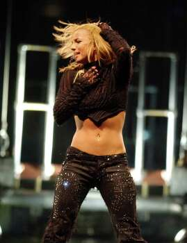 FOR METRO DAILY - Britney Spears performs at the Alamodome Saturday June 15, 2002 in San Antonio, Tx. PHOTO BY EDWARD A. ORNELAS/STAFF Photo: EDWARD A. ORNELAS, SAN ANTONIO EXPRESS-NEWS / SAN ANTONIO EXPRESS-NEWS
