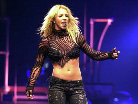 "Britney Spears performs Tuesday, June 4, 2002, in Los Angeles. Two musicians have filed a lawsuit against Spears, claiming that a couple of songs on her multiplatinum second album, ""Oops! ... I Did it Again,'' were based on a tune they wrote.  The lawsuit was filed Friday, June 7, 2002 in U.S. District Court in Philadelphia Photo: KRISTA NILES, AP / AP"