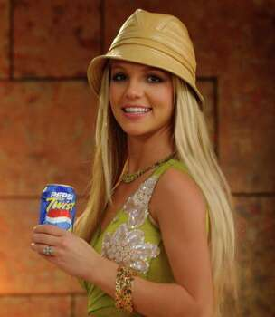 "Entertainer Britney Spears is seen in an undated promotional handout photo. Beginning Sunday, May 19, 2002, Spears and actor Mike Myers will appear in a new national television commercial for Pepsi Twist as part of a promotional campaign with ""Austin Powers in Goldmember."" The spot debuts on the finale of Survivor: Marquesas on CBS.  New Line Cinema's ""Austin Powers in Goldmember"" debuts in theaters July 26. Photo: AP / PEPSI-COLA COMPANY"