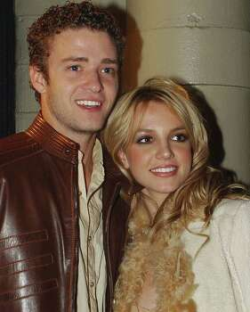 "FILE-- Justin Timberlake of 'NSYNC and Britney Spears pose for photographers at the album release party for Britney's new album ""Britney,"" in this Nov. 6, 2001 file photo, in New York. Photo: LOUIS LANZANO, AP / AP"