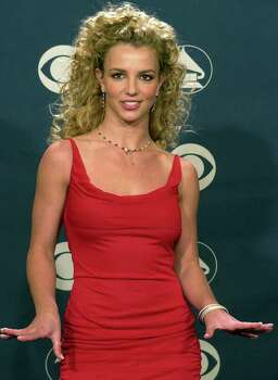 Britney Spears poses after presenting an award during the 44th annual Grammy Awards, Wednesday, Feb. 27, 2002, in Los Angeles. Photo: REED SAXON, AP / AP
