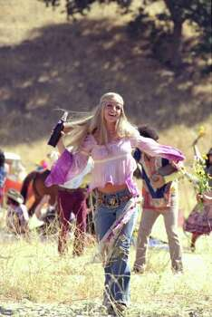Britney Spears is dressed as a hippie in a Pepsi commercial to be braodcast during the Super Bowl.  Spears reprises Pepsi's jingles dating as far back as the 1950s in the commercials . Photo: AP / PEPSI COLA
