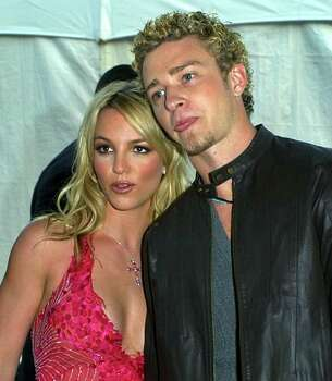 Britney Spears, left, and boyfriend Justin Timberlake of the group N'Sync arrive for the 29th American Music Awards in Los Angeles, Wednesday, Jan. 9, 2002. Photo: KEVORK DJANSEZIAN, AP / AP