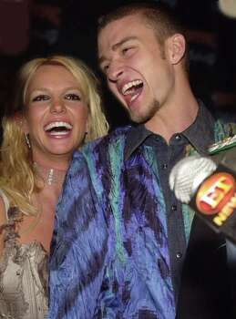 "Music recording artist Britney Spears, left, and NSync band member Justin Timberlake are interviewed by the media while they arrive at the launch party for the band's new album, ""Celebrity,"" Monday, July 23, 2001, in Los Angeles. Photo: CHRIS WEEKS, AP / AP"
