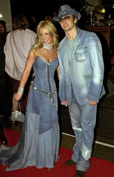 "FILE--Show host Britney Spears, left, and Justin Timberlake of N'Sync arrive at the 28th Annual American Music Awards in Los Angeles in this Jan. 8, 2001 file photo.  Spears doesn't want to be considered a role model when it comes to sex and relationships.  ""I just want to live my life,'' she tells Us Weekly magazine in its June 4 , 2001 issue.  She also doesn't want to discuss the intimate details of her romance with Timberlake, which has been a topic of rampant speculation. Photo: MARK J. TERRILL, AP / AP"