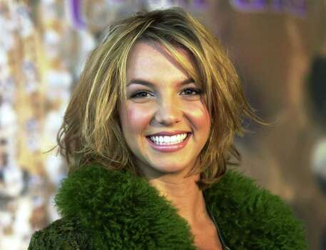 "FILE--Britney Spears smiles for photographers during a news conference in Cologne, Germany in this April 17, 2000 file photo.      Spears received a Grammy nomination Wednesday, Jan. 3, 2001, for pop vocal album of the year ""Oops! ... I Did It Again."" Photo: HERMANN J. KNIPPERTZ, AP / AP"