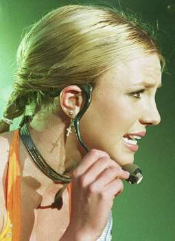 "U.S. popstar Britney Spears has a little microphone clip around her ear during her concert in Bremen, northwest Germany, Tuesday, Oct. 17, 2000. She started her ""Oops'...I Did It Again"" tour throughout Germany in Bremen. Photo: JOERG SARBACH, AP / AP"