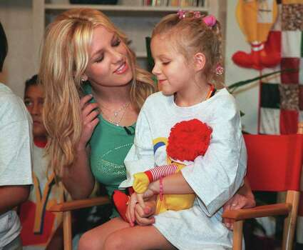 DAILY FOR METRO AND FOR AP WIRE-- Music pop artist Britney Spears visits with Taylor McClintock, a resident of the Ronald McDonald House of San Antonio, thursday July 20, 2000.  Spears, who was in San Antonio for her concert Thursday night, visited the Ronald McDonald House to promote an upcoming CD  and video release with other top international artists including NSYNC, Sisqo and Enrique Iglesias.  Rick Hunter/Staff Photo: Rick Hunter, E/N / E/N