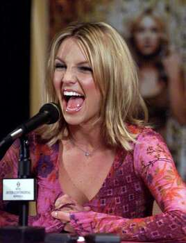 "Pop star Britney Spears laughs when asked a question during a news conference for the Canadian launch of her latest album ""Oops ... I Did It Again"" Wednesday, May 17, 2000 in Montreal. Photo: PAUL CHIASSON, AP / CP"