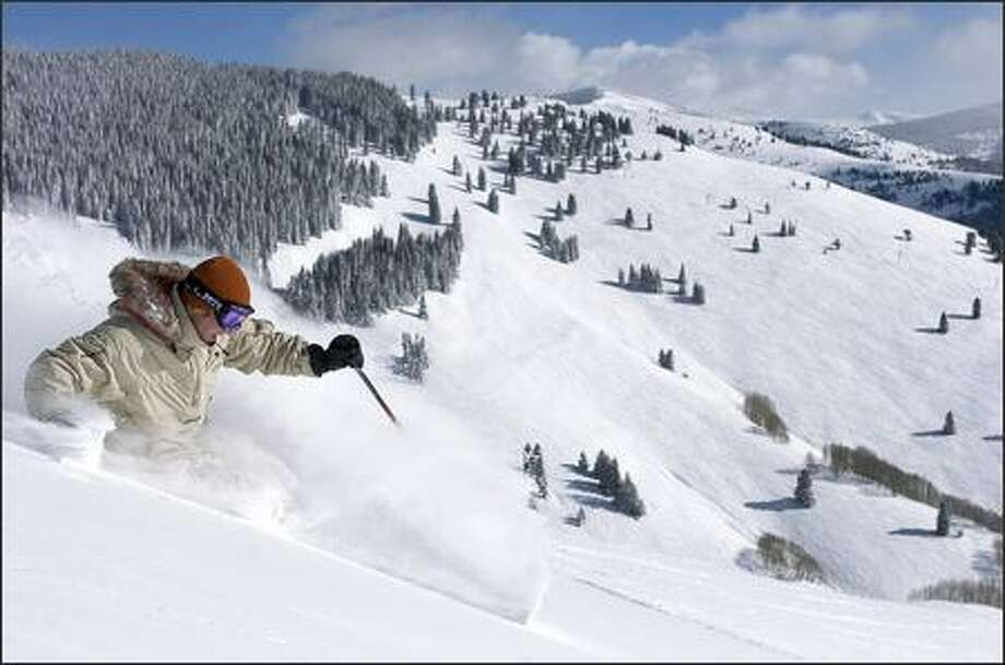 Chris Anthony rips through the powder on the Seldom run at Vail Mountain Resort in Colorado. Photo: Matt Inden/Vail Daily 2005