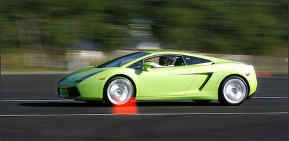 """Bryce Irwin of Renton found the test-drive of a Lamborghini Gallardo """"fantastic, a once in a lifetime opportunity."""" Photo: Gilbert W. Arias/Seattle Post-Intelligencer"""
