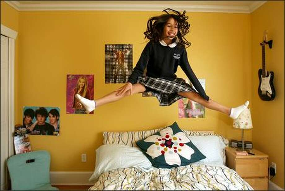 Katie French is floating on air knowing that she and a friend are going to the Hannah Montana concert Monday. Her West Seattle bedroom pays tribute to her idol. Photo: Mike Urban/Seattle Post-Intelligencer