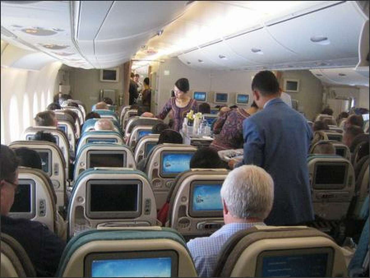 Economy class on Singapore Airlines' A380 boasts wider seats with more legroom.