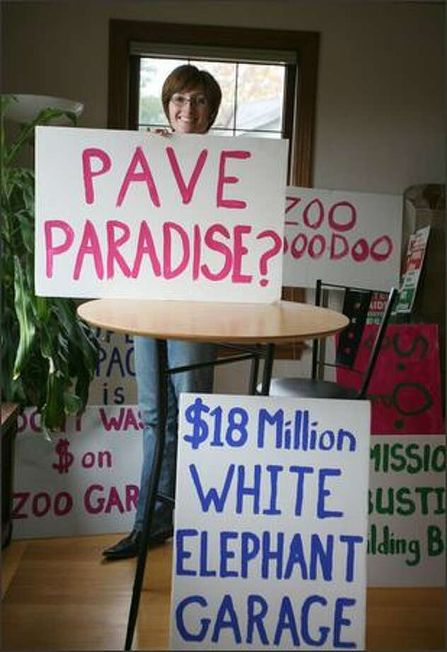 Phinney Ridge resident Diane Duthweiler will be recycling signs that she and neighbors made to protest the proposed construction of a parking garage at Woodland Park Zoo. Photo: Paul Joseph Brown/Seattle Post-Intelligencer