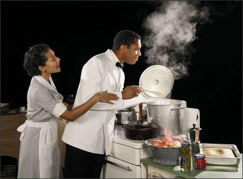 Julio (A.K. Murtadha) works magic in the kitchen at Gladys' (Zabryna Guevara) restaurant. Photo: Chris Bennion