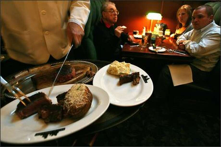 The Metropolitan Grill offers some of the most expensive cuts of meat in town, with many options hitting three figures. Photo: Mike Urban/Seattle Post-Intelligencer
