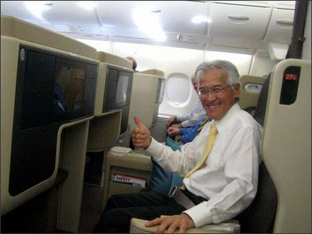 Singapore Airlines CEO Chew Choon Seng, seated in the last row of business seats on the upper deck, applauded and cheered with other passengers on both decks as the plane's wheels lifted off the runway in Singapore Photo: James Wallace/Seattle Post-Intelligencer
