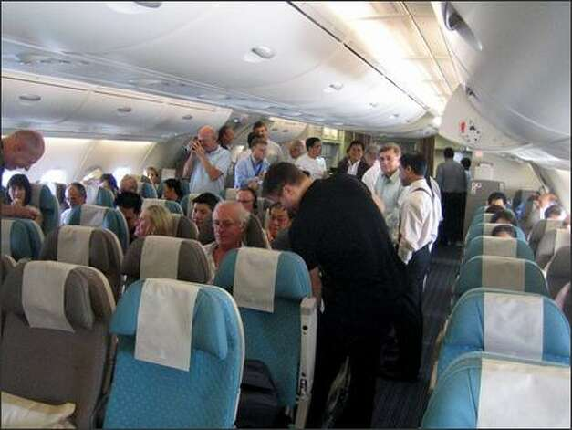 "The scene in economy class, described as a ""party atmosphere."" Photo: James Wallace/Seattle Post-Intelligencer"