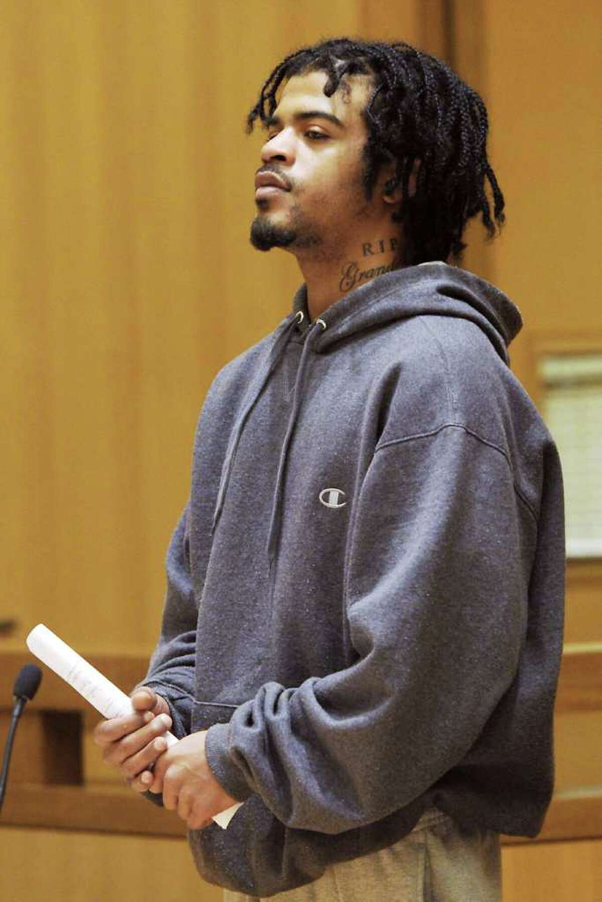 David Davis is arraigned in State Superior Court of Stamford, Conn. on Tuesday March 22, 2011. Davis, 21, allegedly grabbed scissors and slashed another in the back while getting his hair cut in the South End last week, police said.