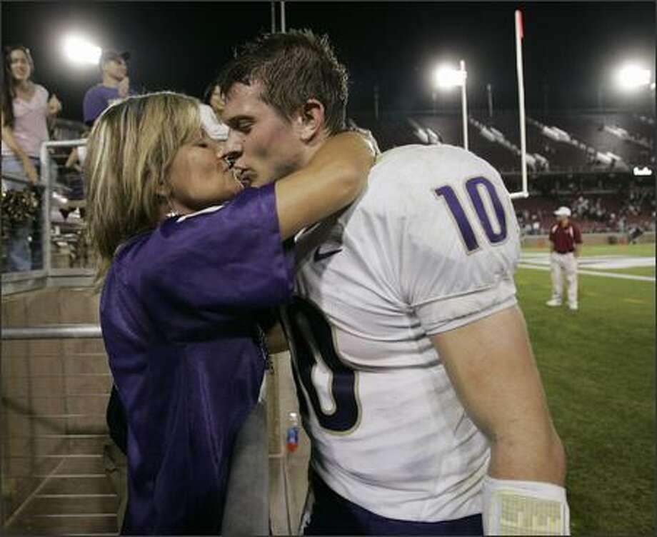Washington quarterback Jake Locker kisses his mother, Anita Locker, after Washington defeated Stanford 27-9. (AP Photo/Paul Sakuma) Photo: / Associated Press