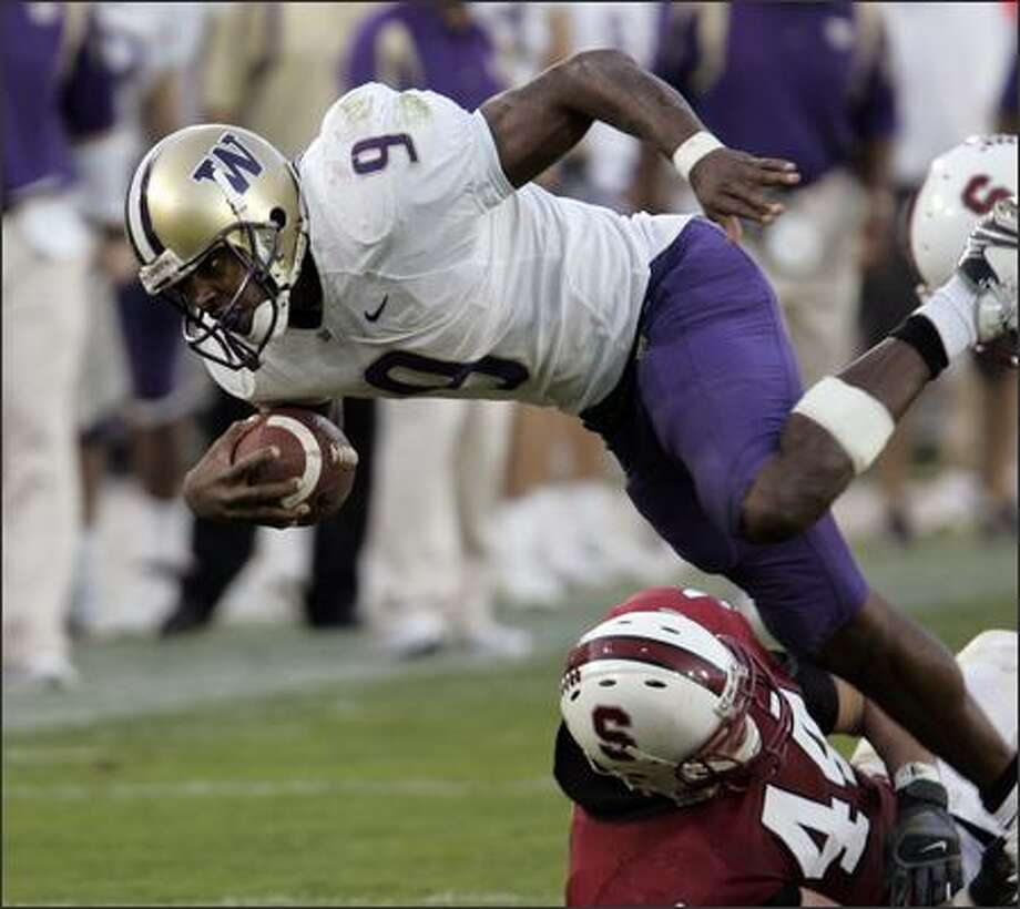 Washington running back Louis Rankin (9) runs over Stanford linebacker Pat Maynor (44) in the fourth quarter. (AP Photo/Paul Sakuma) Photo: / Associated Press