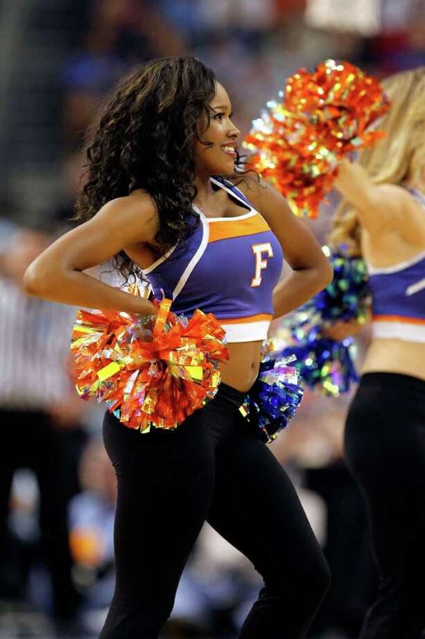 TAMPA, FL - MARCH 19:  A cheerleader for the Florida Gators performs aganst the UCLA Bruins during the third round of the 2011 NCAA men's basketball tournament at St. Pete Times Forum on March 19, 2011 in Tampa, Florida. Florida won 73-65. (Photo by J. Meric/Getty Images) Photo: J. Meric, Getty Images / 2011 Getty Images
