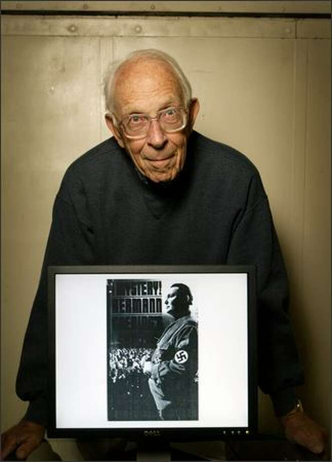 Jack Carver holds a portrait of top-ranking Nazi Hermann Goering, whom he met while a prison guard during the Nuremberg trials in Germany after World War II. The prison was attached to the courthouse. Photo: Joshua Trujillo/Seattle Post-Intelligencer