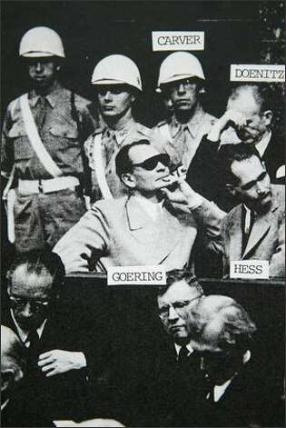 Jack Carver stands behind Hermann Goering during the Nazi's trial in postwar Nuremberg. (Photo courtesy of Jack Carver) Photo: / Family Photo