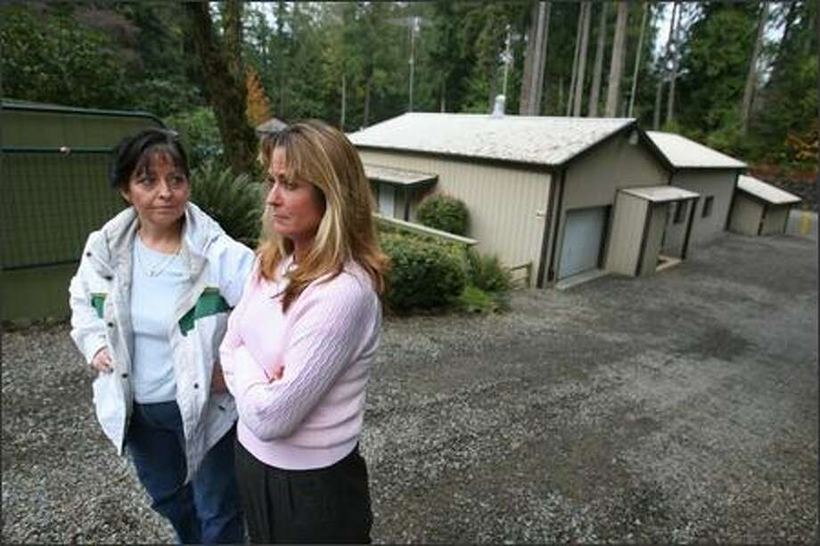 Sisters Danel Swan, right, and Debra Phelps used to attend The Church, in the background at the complex in Port Orchard, which was led by Robbin Leeroy Harper, who has been accused by five young women of sexual abuse. Swan and Phelps' 20-year-old niece was the first to make a report to police. Harper had been molesting her since age 12, the young woman said. Photo: Scott Eklund/Seattle Post-Intelligencer