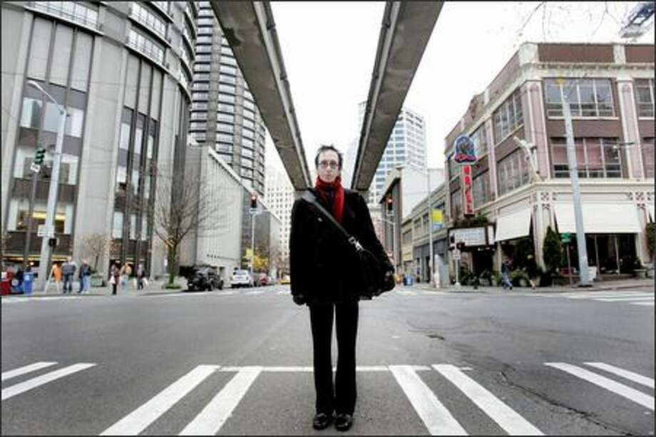 """Musician Marco UnderSong calls the area near 5th Avenue and Virginia Street the """"Under the Rail"""" neighborhood, after a long defunct club. Condo marketers have recently branded the area as """"Midtown"""" Seattle. Photo: Meryl Schenker/Seattle Post-Intelligencer"""