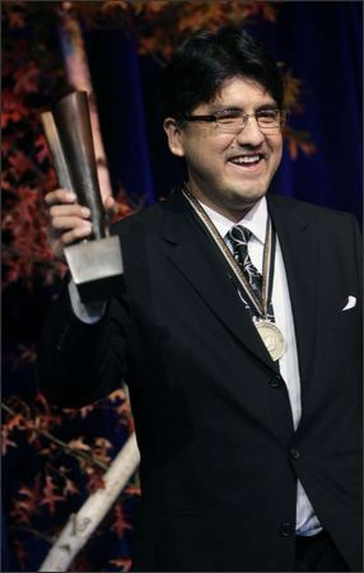 """Sherman Alexie accepts the National Book Award for Young People's Literature for his book """"The Absolutely True Diary of a Part-Time Indian"""" at the 58th National Book Awards in New York."""