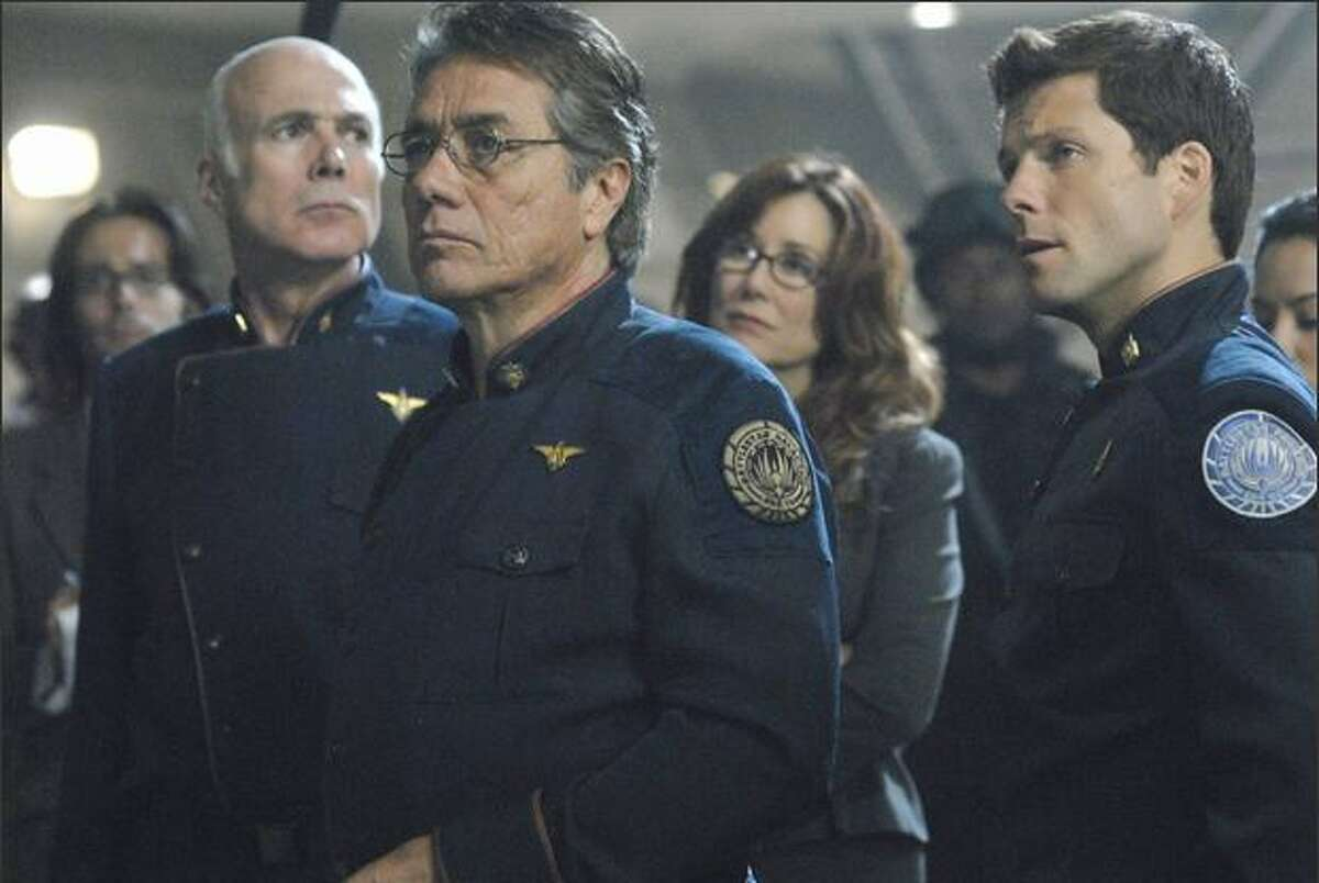"""Key """"Battlestar Galactica"""" players: from left, Col. Tigh (Michael Hogan), Admiral Adama (Edward James Olmos), President Roslin (Mary McDonnell) and Apollo (Jamie Bamber)."""