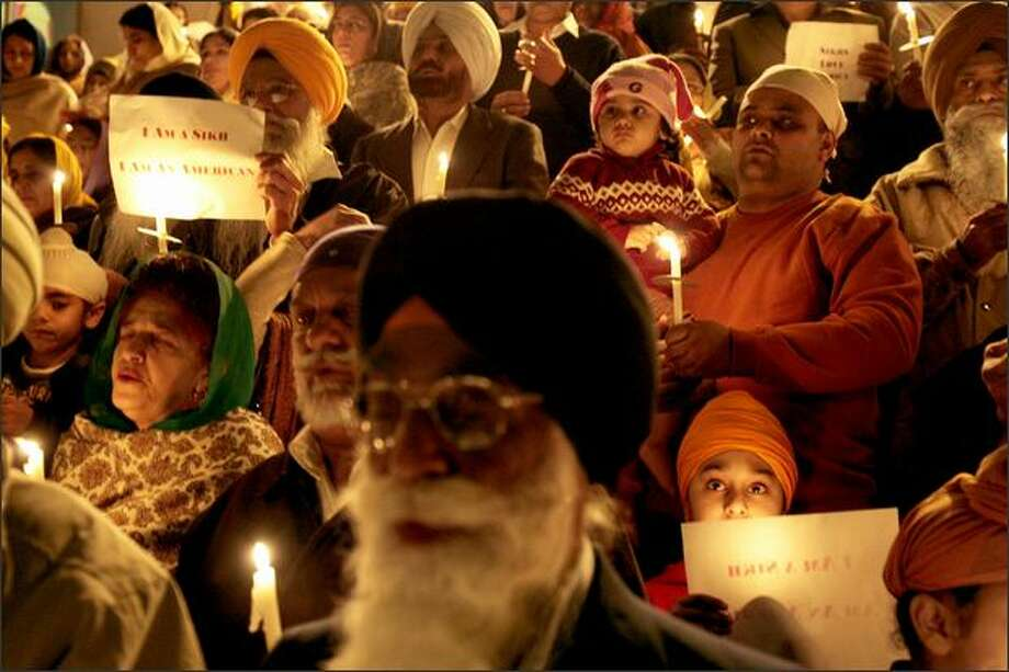 Hundreds in the Sikh community held a vigil Wednesday for taxi driver Sukhvir Singh, who was assaulted Saturday, at Gurdwara Singh Sabha of Washington in Renton. Photo: Meryl Schenker/Seattle Post-Intelligencer