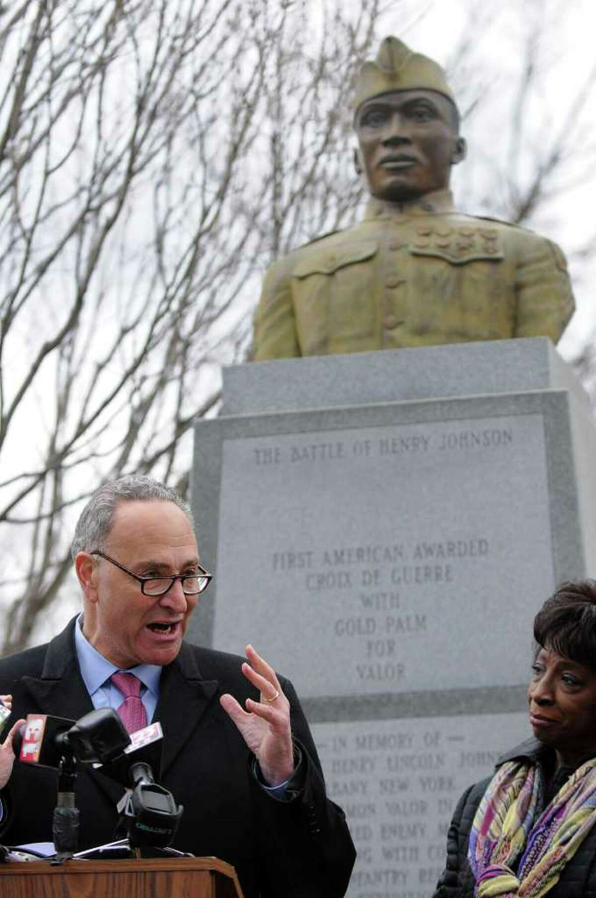 U.S. Senator Charles E. Schumer announces that newly discovered documents will enhance Sgt. Henry Johnson's chance of receiving the Medal of Honor, at the World War I hero's statue in Washington Park on Tuesday, March 22, 2011, in Albany, NY. Albany County Legislator Lucille McKnight is at right. ( Philip Kamrass/ Times Union )