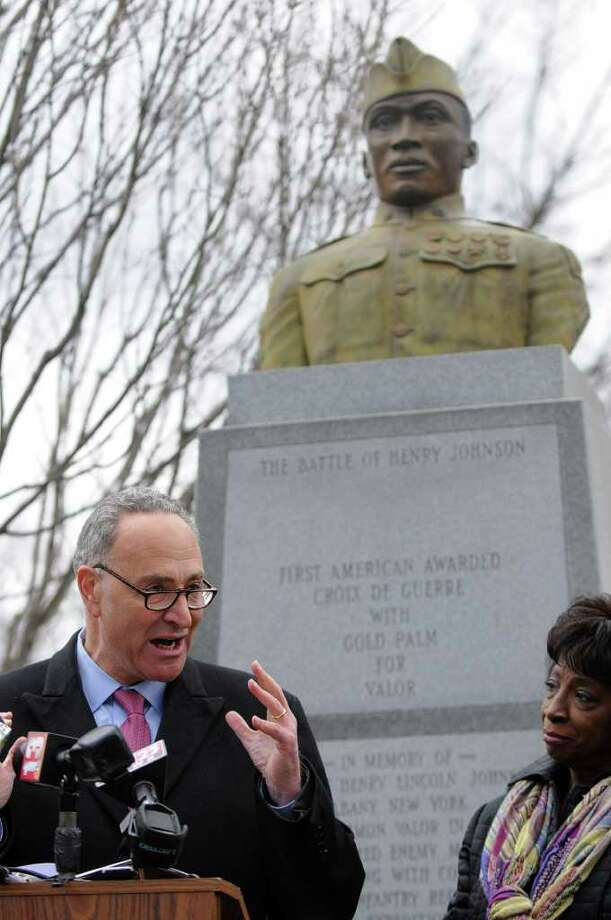 U.S. Senator Charles E. Schumer announces that newly discovered documents will enhance Sgt. Henry Johnson's chance of receiving the Medal of Honor, at the World War I hero's statue in Washington Park on Tuesday, March 22, 2011, in Albany, NY.  Albany County Legislator Lucille McKnight is at right. ( Philip Kamrass/ Times Union ) Photo: Philip Kamrass