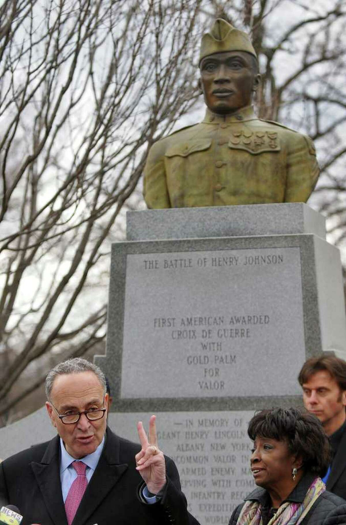 U.S. Senator Charles E. Schumer announces that newly discovered documents will enhance Sgt. Henry Johnson's chance of receiving the Medal of Honor, at the World War I hero's statue in Washington Park on Tuesday, March 22, 2011 in Albany, NY. Albany County Legislators Lucille McKnight and Brian Scavo are at right. ( Philip Kamrass/ Times Union )