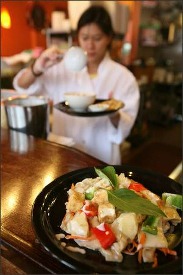 Spicy coconut milk noodle, with rice noodles and tofu at In the Bowl bistro. Photo: Paul Joseph Brown/Seattle Post-Intelligencer