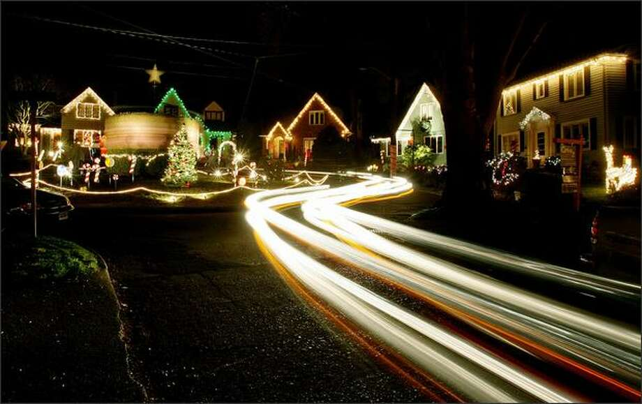 "Cars' lights leave trails in this 30-second exposure as they navigate through ""Candy Cane Lane"" in Seattle's Ravenna neighborhood on Wednesday. Photo: Dan DeLong/Seattle Post-Intelligencer"