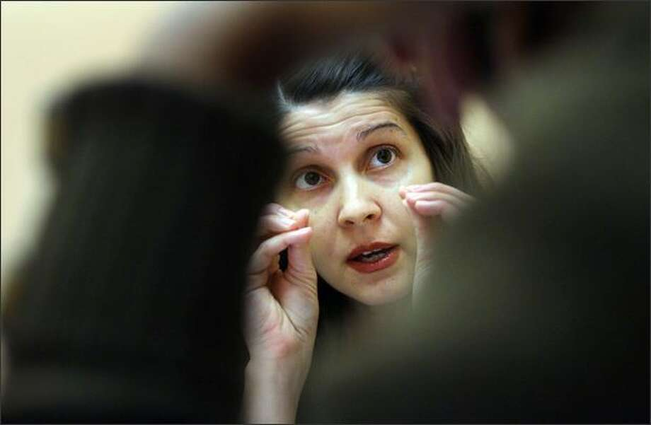 Elena Atanasova tutors a South Seattle Community College student recently who was preparing to take a nursing board exam. Atanasova is a nurse from Bulgaria seeking certification here. Photo: Dan DeLong/Seattle Post-Intelligencer