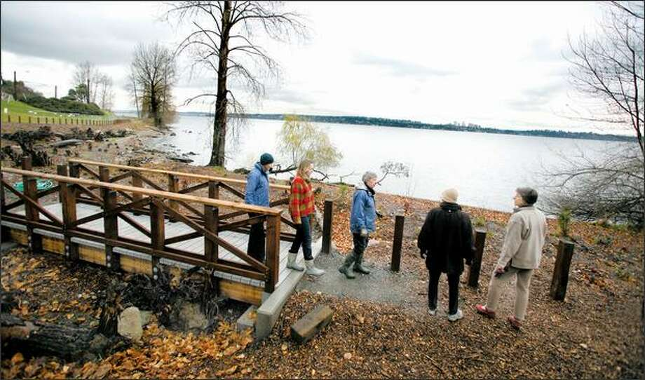 A group of neighbors, Friends of Madrona Woods, tour their restoration project Monday. It reconnected Madrona Creek with Lake Washington. Photo: Paul Joseph Brown/Seattle Post-Intelligencer