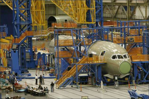 The first 787 Dreamliner, assembled in May in Boeing's Everett factory, ran into delays when work by Boeing's partners wasn't completed. Photo: Grant M. Haller/Seattle Post-Intelligencer